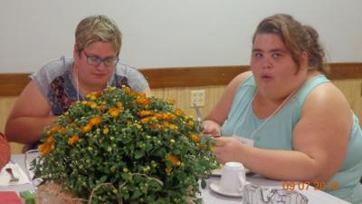 two ladies enjoy dinner at the retreat